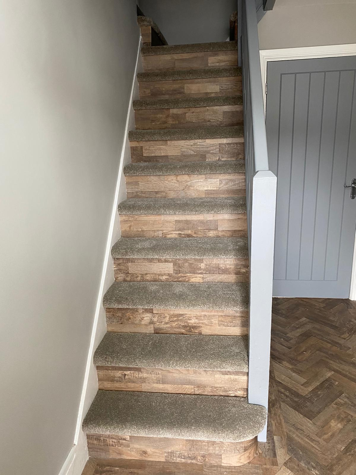 Luxury carpet to stairs with LVT riser and LVT to hall
