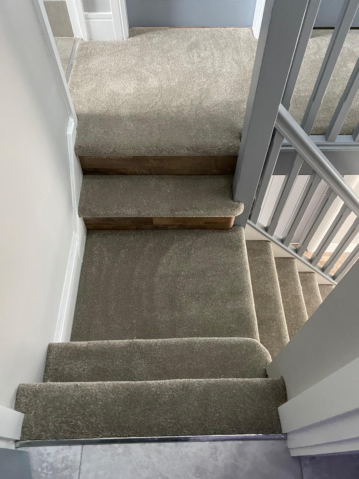 Luxury carpet to stairs with LVT riser
