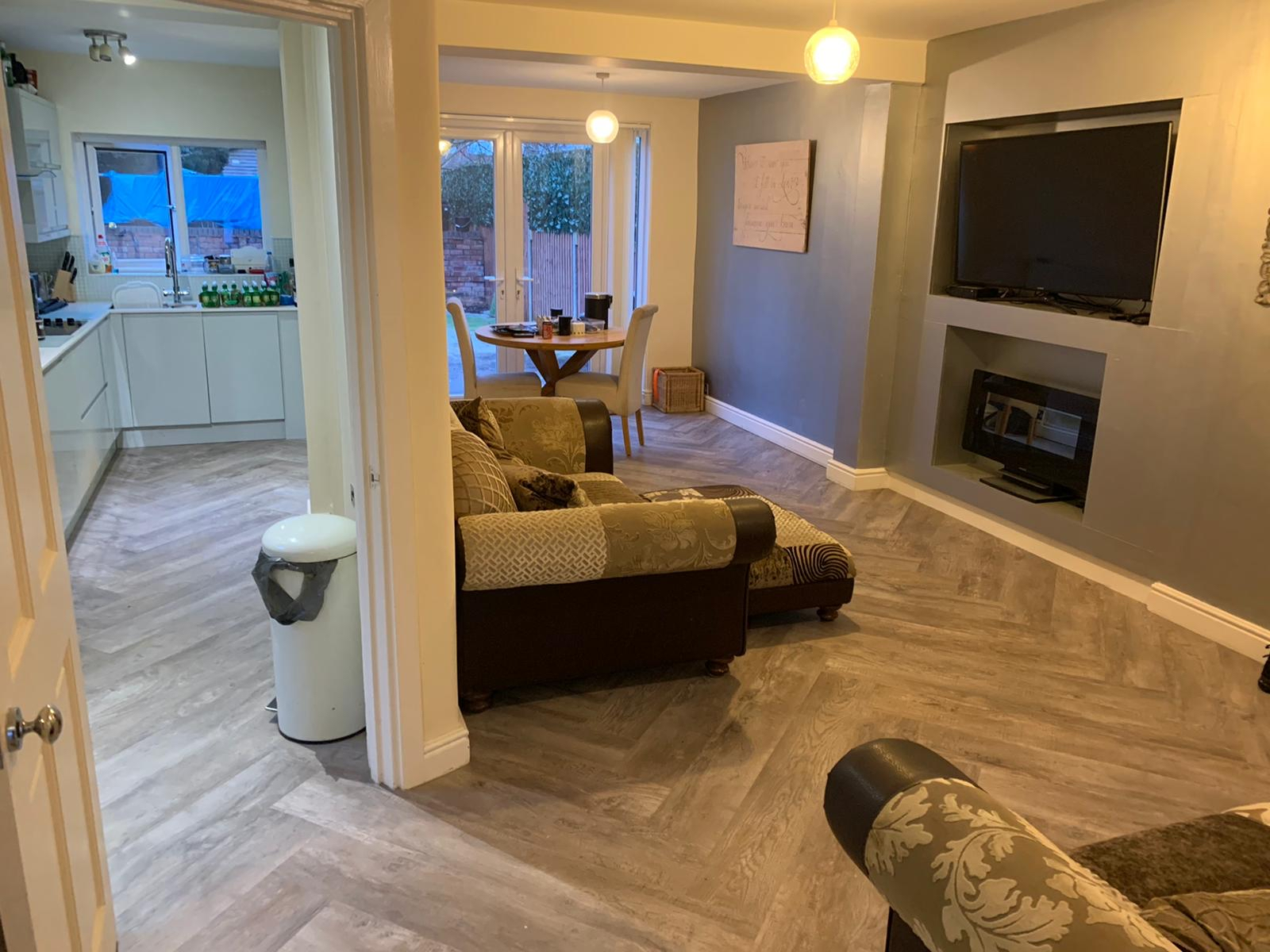 Karndean in large herringbone pattern to kitchen and family room
