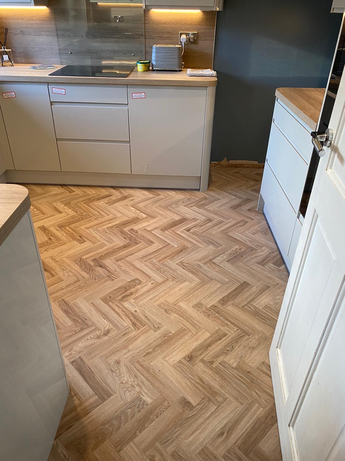 LVT in large herringbone pattern to kitchen and family roomeh