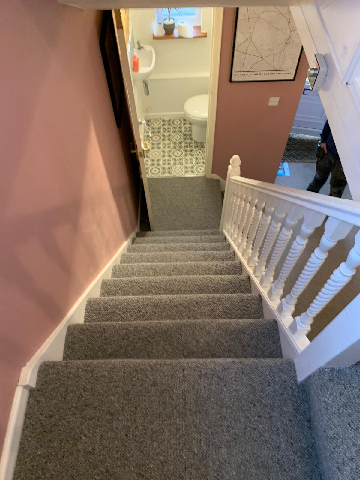 Carpet and vinyl to hall and stairs and cloakroom