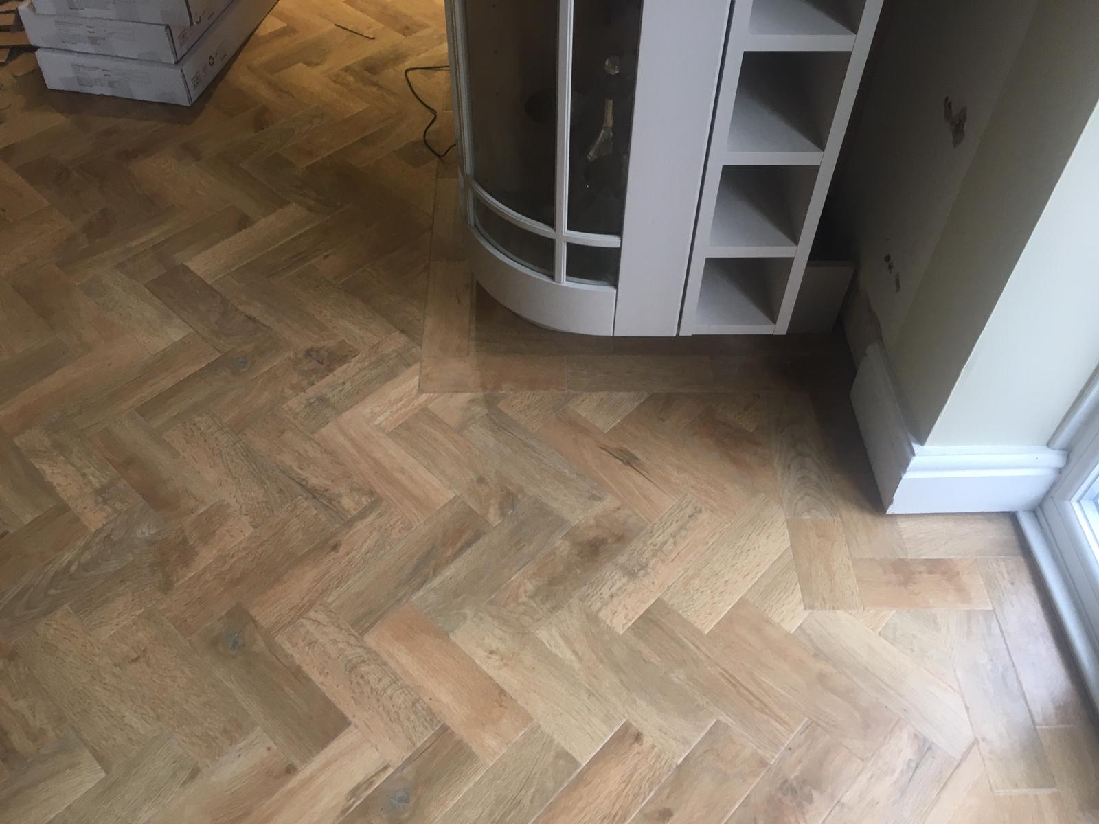 Karndean herringbone pattern with border to kitchen and family room